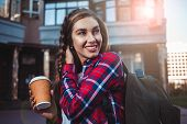 Awesome Girl In Urban Style Walk In City With Coffee. poster