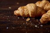 Tasty Buttery Croissants On An Old Wooden Table, Close-up, Selective Focus, Shallow Depth Of Field.  poster