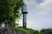 The Old Water Tower Provides Water To The Village. Water Tower With Water poster