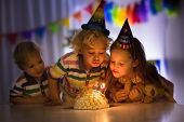Kids Birthday Party. Children Blow Cake Candles. poster