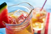 closeup of a glass pitcher with refreshing spanish sangria blanca, white sangria, with pieces of fre poster