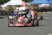 stock photo of karts  - A line of racing go karts in a race - JPG