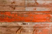 Old Weathered Wood With Weathered Peeling And Flaking Red Paint Background Texture In A Full Frame V poster