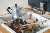 Full Sink Of Dirty Dirty Dishes. The Concept Of The Lack Of A Dishwasher Or Water. poster