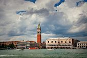 Waterfront view of Bell Tower and historical buildings at Piazza San Marco in Venice, Italy. poster
