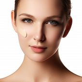 Beautiful Face Of Young Woman With Cosmetic Foundation On A Skin. Beauty Treatment Concept. Makeup A poster