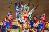 BEIJING, CHINA - NOVEMBER 16: Artists acting as soldiers and a general perform a Peking opera show o