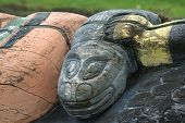 stock photo of tlingit  - Detail of carved salmon in eagle talons on Tlingit Alaska Native totem pole on historic Shakes Island at Wrangell - JPG