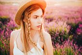 A Blonde Hippie Girl With Braids In A Straw Hat, In A Lavender Field. poster