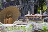 Japanese Style Picnic Near Ancient Temple Of Angkor Wat Complex, Cambodia. Picnic With Umbrella And  poster