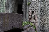 Ancient Stone Ruin In Angkor Wat Temple. Stone Carved Human Figure And Floral. Khmer Heritage Temple poster