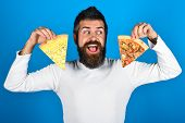 Bearded Man Holds Two Pieces Of Pizza In His Hands. Happy Hungry Man Eating Pizza. Handsome Man With poster