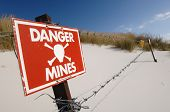 image of landmines  - A signpost warning of the danger of landmines left on a beach during the Argentinian invasion of the Falkland Islands in 1982 - JPG