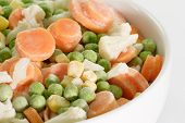 stock photo of frozen food  - Frozen vegetables in a bowl on light background - JPG
