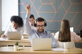 Excited Male Employee Wearing Headset Dancing At Workplace, Working At Laptop In Coworking Space, Ex poster