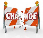 The word Change on a barrier being broken through to allow for evolution, revolution, adapting, prog