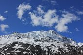Snowy Mountains Against The Blue Sky With White Clouds. Mountains Of Nepal poster