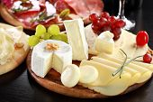 foto of salami  - Cheese and salami platter with vegetable and herbs - JPG