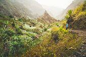 Santo Antao Island, Cape Verde. Traveler Man On Hike Path In Ribeira Da Torre. Mountain Ridge And Ra poster