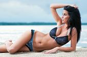 image of swimsuit model  - Beautiful young woman relaxing on the beach - JPG