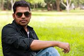 Photo Of An Handsome, Stylish, Casual And Young Indian/south Indian Youth With Sunglasses Looking At