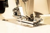 Presser Foot Of Sewing Machine With Needle And Thread Close Up. Detail Of Sewing Machine. The Sewing poster