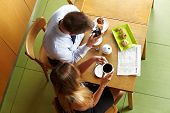Business people sitting with smartphone in a caf�?�© for a meeting