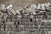 disorganized vintage grunge metal letterpress printing blocks on a tray