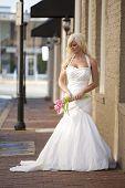 Bride Posing on a Brick Sidewalk