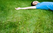 Young Man Lying On The Grass