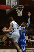 KAPOSVAR, HUNGARY - FEBRUARY 22: Balazs Szoke (in white) in action at a Hungarian Cup basketball gam