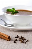picture of ou  - Chocolate mousse ou a white mug with mint leaves and spoon - JPG