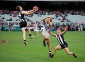 MELBOURNE - JUNE 30 : Alan Tookey rushes in to take a mark during Collingwood's win over Fremantle o