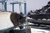 STUART, FL - MARCH 30: The charred fiberglass hulls of two boats now in dry dock at the Sailfish Marina in Stuart, Florida on March 30, 2011. The boats were destroyed in the fire.