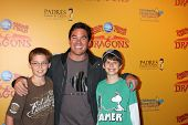LOS ANGELES - JUL 12:  Dean Cain and son (in brown), friend (Green) arrives at 'Dragons' presented b