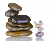 Stacks of balanced stones isolated on white