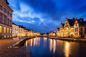 Travel Europe Belgium background - Ghent canal, Graslei and Korenlei streets in twlight the evening. Ghent, Belgium