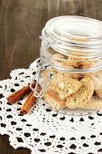 Aromatic cookies cantuccini on bank on wooden table close-up