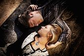 foto of morbid  - couple looking at each other while laying in opposite directions - JPG