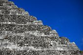 A picture of Chitchen-Itza pyramid steps over blue sky