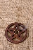 picture of pentacle  - close up of wooden pentacle incense burner with hessian background - JPG