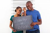 fun african young couple guilty of love