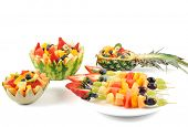Fresh fruit salad of mango, strawberry, kiwi, grapes, strawberries blueberries banana in a bowl from