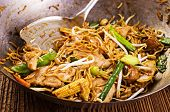 stir fried noodles in wok