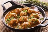 meatballs cooked in tomato sauce