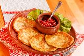 potato pancakes with cranberry sauce