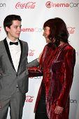 LAS VEGAS - APR 18:  Asa Butterfield, Jacqueline Farr in the CinemaCon Big Scrren Achievement Awards