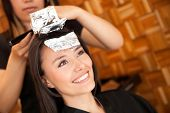 image of hair dye  - Woman dying her hair at the beauty salon - JPG
