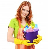 Young housewife with bucket of cleaning supplies, isolated on white