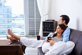 pic of couch  - Couple relax at home with cup of coffee and sofa couch - JPG